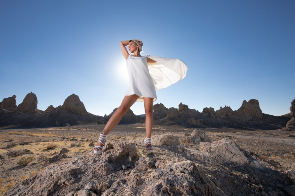 Desert Trona Pinnacles white dress beautiful women blue sky mojave desert